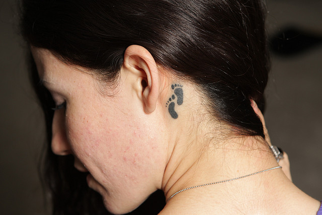 Creative Tiny Footprints Tattoo Below Ear For Girls