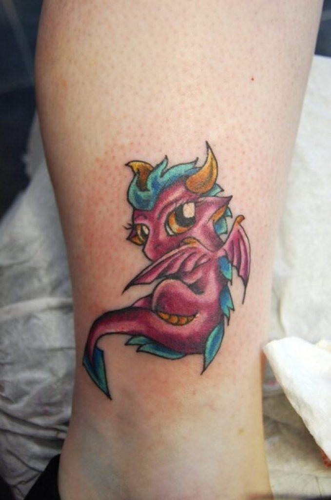 Cute Dragon Fantasy Tattoo On Leg For Girls