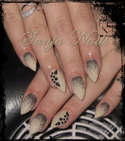 Dashing Black And Beige Nail Art With Sharp Nail Design