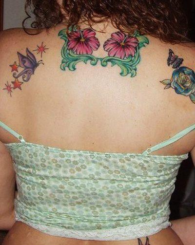 Elegant Flower Tattoo On Upper Back For Girls