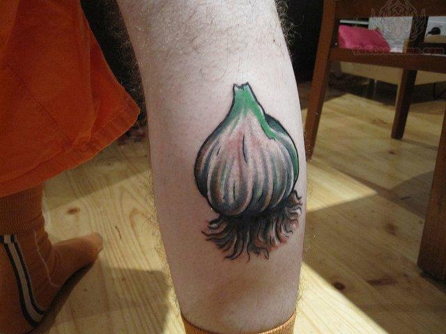 Elegant Garlic Tattoo On Right Leg For Boys