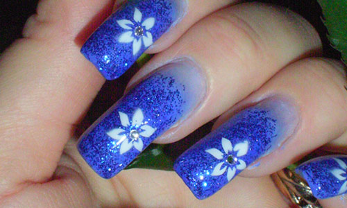Eye Catching Blue Nail With Flower Design
