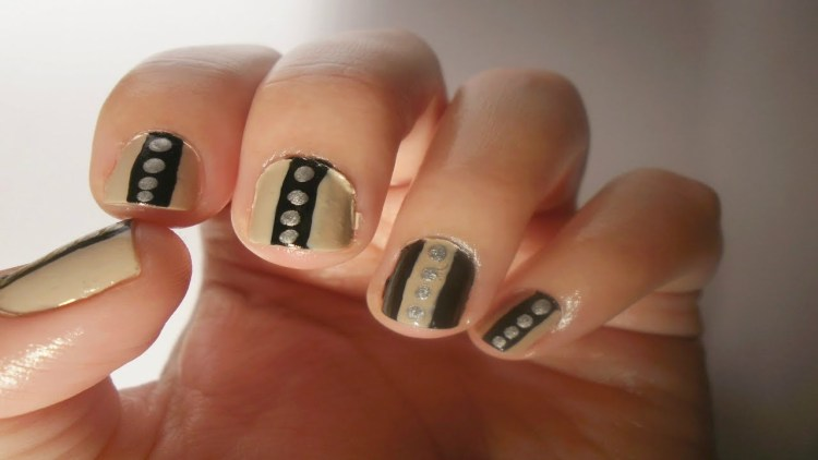 Fabulous Black And Beige Nal Art With Crystal Design