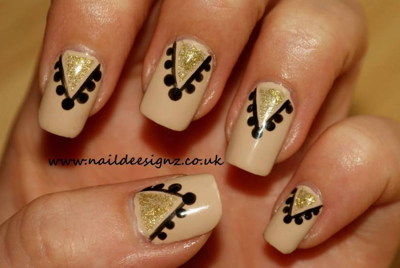 Fantastic Black And  Beige Nail Art With Golden Paint Design