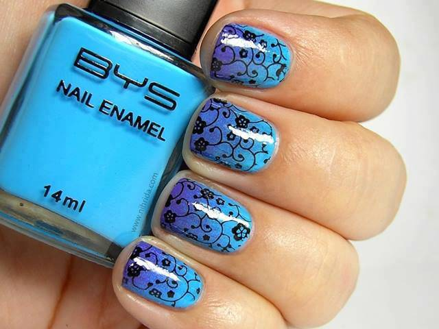 Fantastic Blue Nail Art With Black Color Flower Design