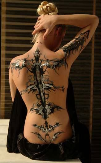 Glowing Extreme Sword Tattoo On Back For Girls