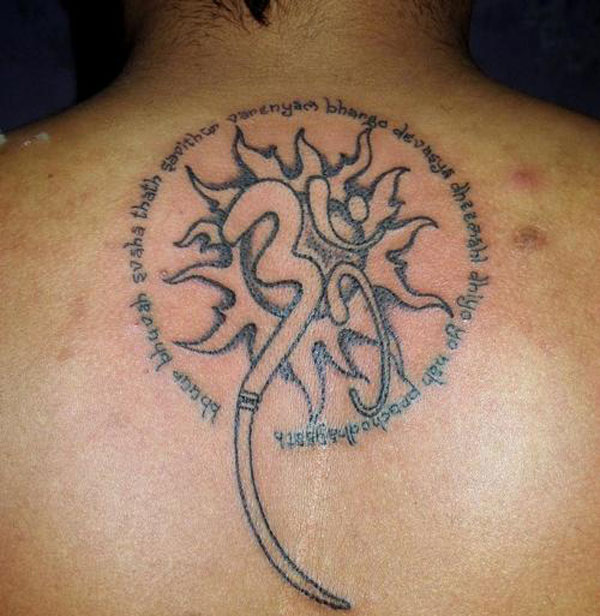 Glowing Om Tattoo On Upper Back For Boys