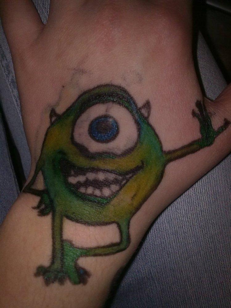 Great Cartoon Alien Hand Tattoo For Boys