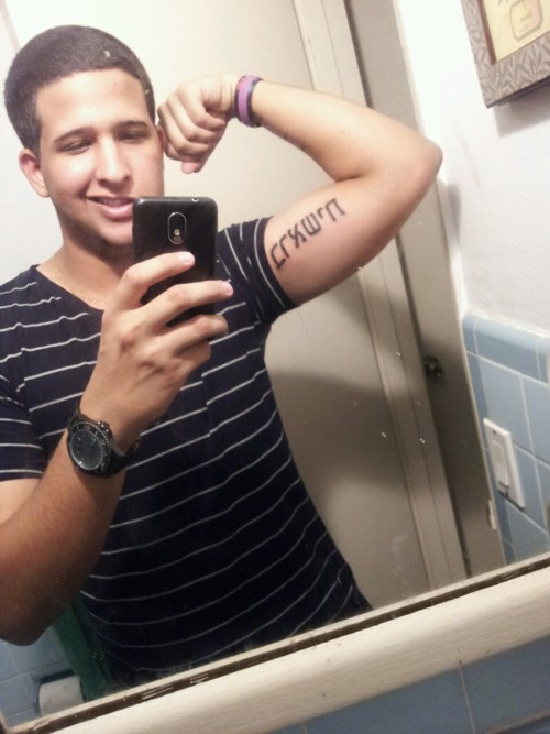 Groovy Hebrew Script Tattoo On Muscles For Boys