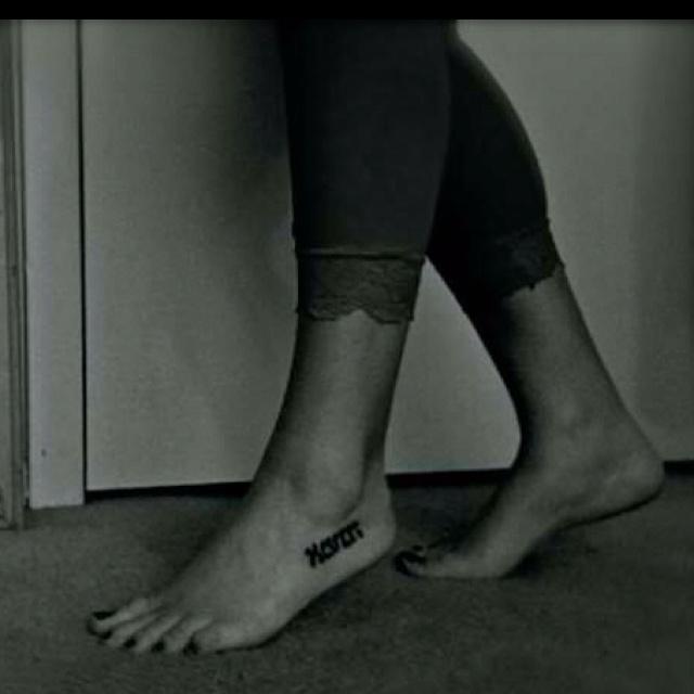 Impressive Hebrew Tattoo On Left Foot For Boys