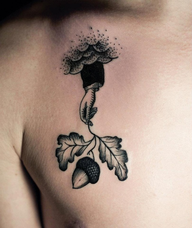 Innovative Hand Held Leafs Tattoo On Chest For Boys