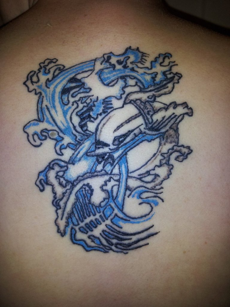 Innovative Upper Back Dolphin Tattoo Design For Boys