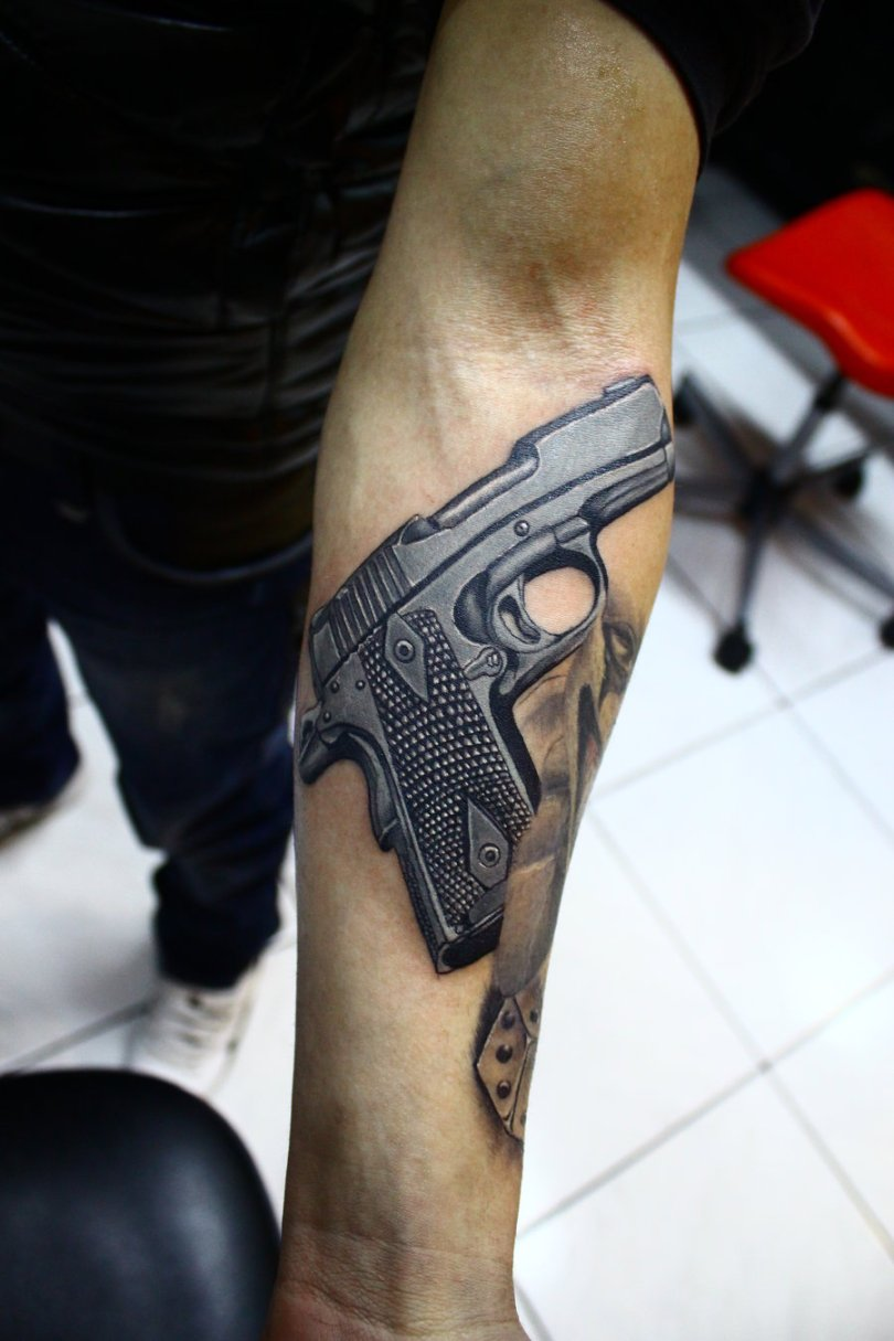 Inspirational Gun Tattoo Design On Arm For Boys