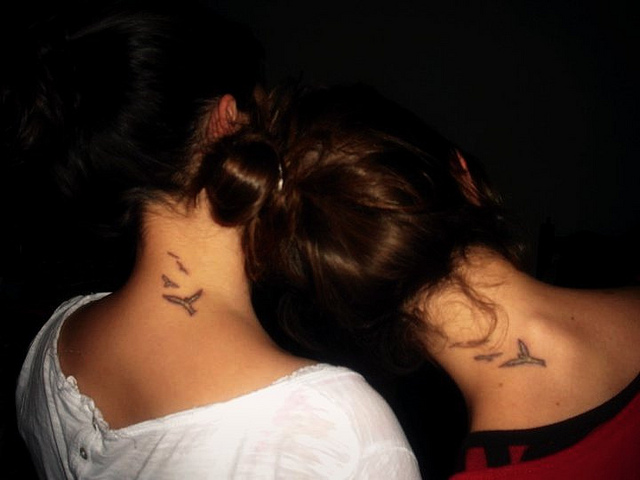 Lovely Birds Tattoo On Back Neck For Girls