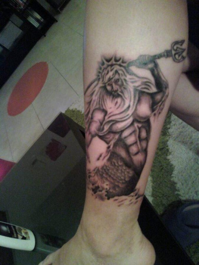 Lovely Greek God Tattoo On Leg For Girls