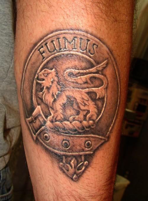 Maori Family Crest Tattoo On Leg For Boys