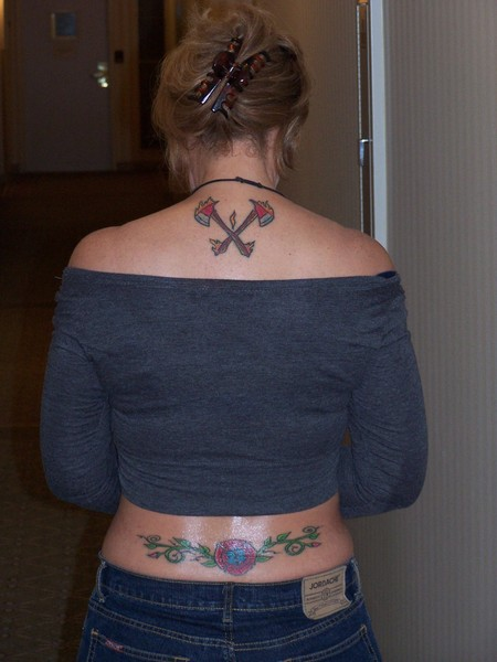 Mind Blowing Firefighter Tattoo On Upper Back For Girls