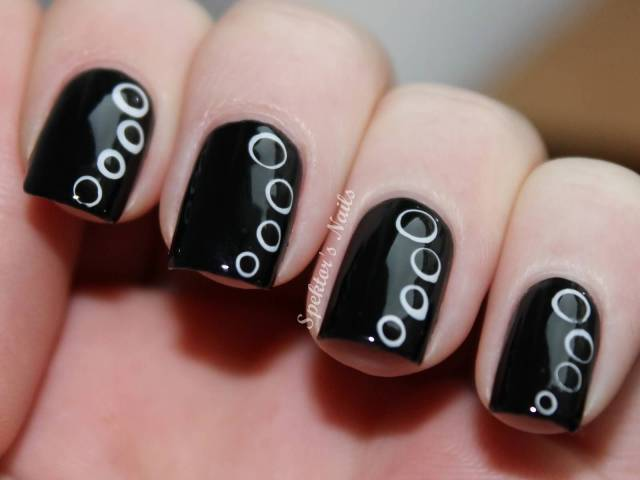 Most Incredible Black Nail Art With Round Planet Design