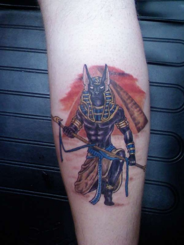 Nice Egyptian Anubis Tattoo On Back Leg For Girls