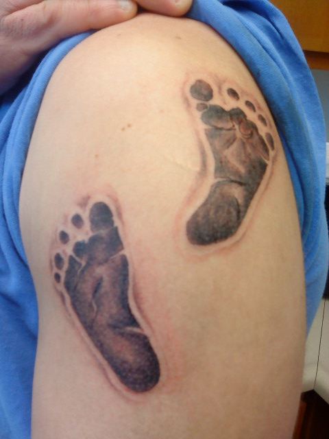 Realistic Footprints Tattoo On Upper Arm To Shoulder For Boys