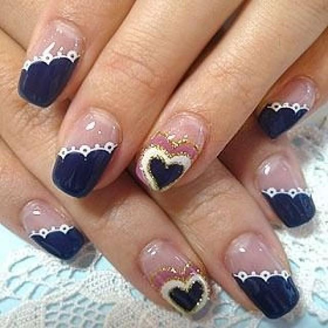Stunning Blue Nail Art With Heart Design