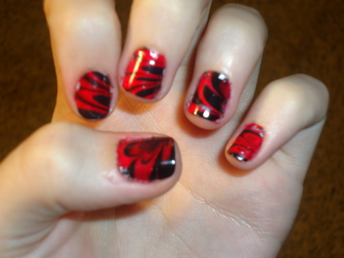 Stunning Red And Black Nails With Tiger Print Design