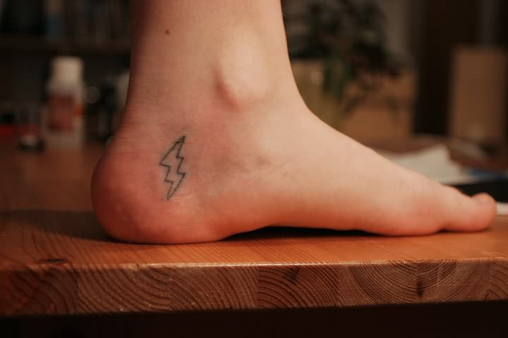 Superb Energy Symbol Tattoo On Heel For Girls