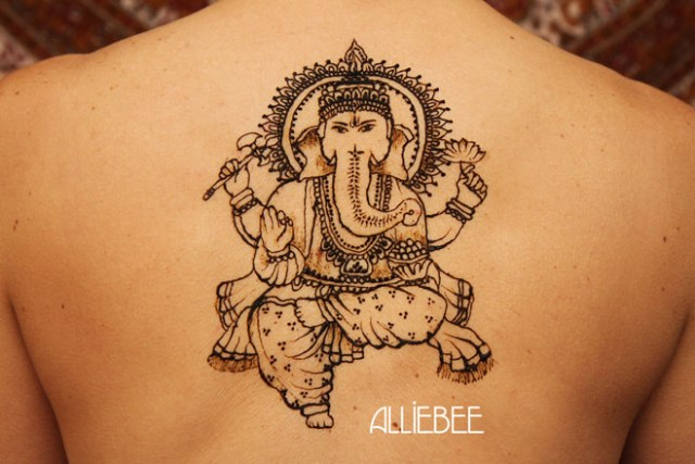 Superb Henna Ganesh Tattoo Design On Upper Back For Boys