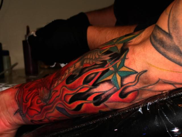 Superb Red Flame Tattoo On Arm For Boys