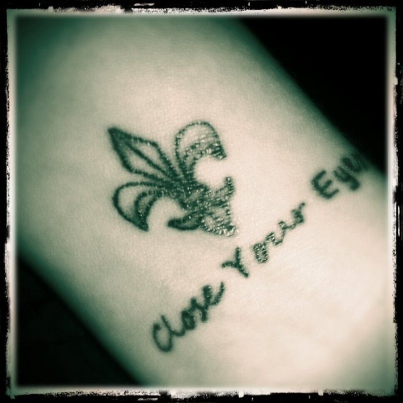 Sweet Fleur De Lis Close Your Eyes Tattoo Design For Boys And Girls
