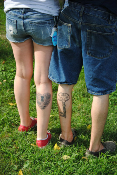 Sweet Friendship Tattoo On Back Legs For Boys
