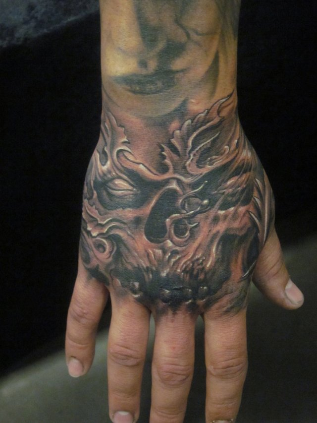 Terrific Demon Hand Tattoo Design For Boys