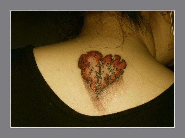 Traditional Broken Heart Tattoo On Upper Back For Girls