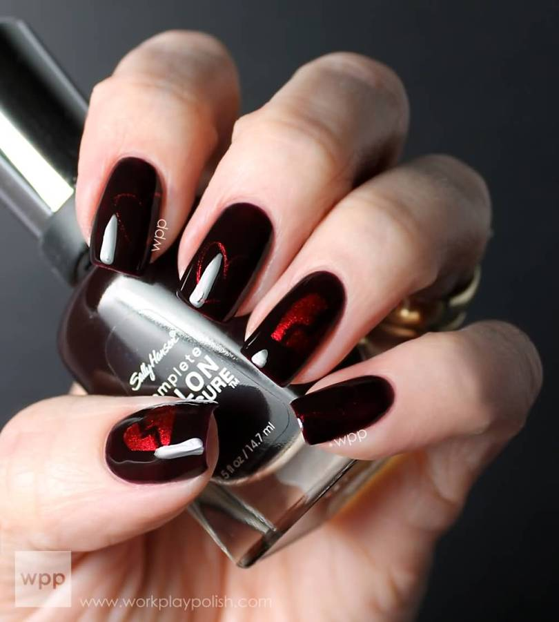 Unique Black Nail Art Design With Red Paint Design