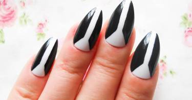 Unique Design Of Black And White Almond Shaped Acrylic Nail Art