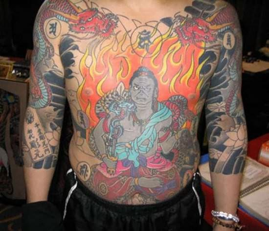 Weird Fire n Flames Tattoo On Chest For Boys