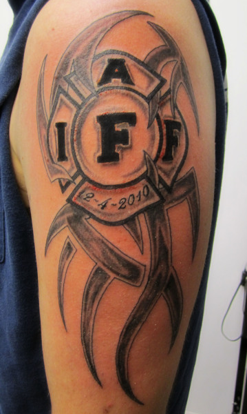 Weird Firefighter Tribal Tattoo Design On Shoulder For Boys