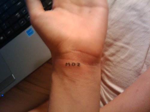 Weird Homemade Text Tattoo On Wrist For Boys