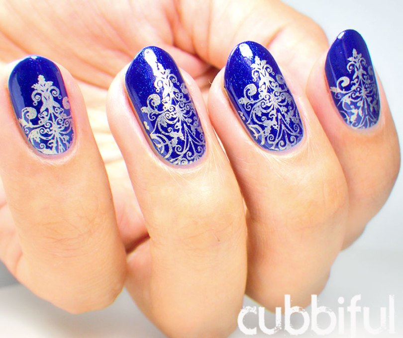 Awesome Marble Design On Blue Nails
