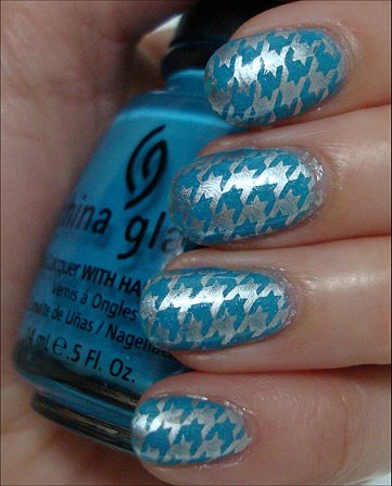 Stunning Blue And Silver Nails With Bat Design