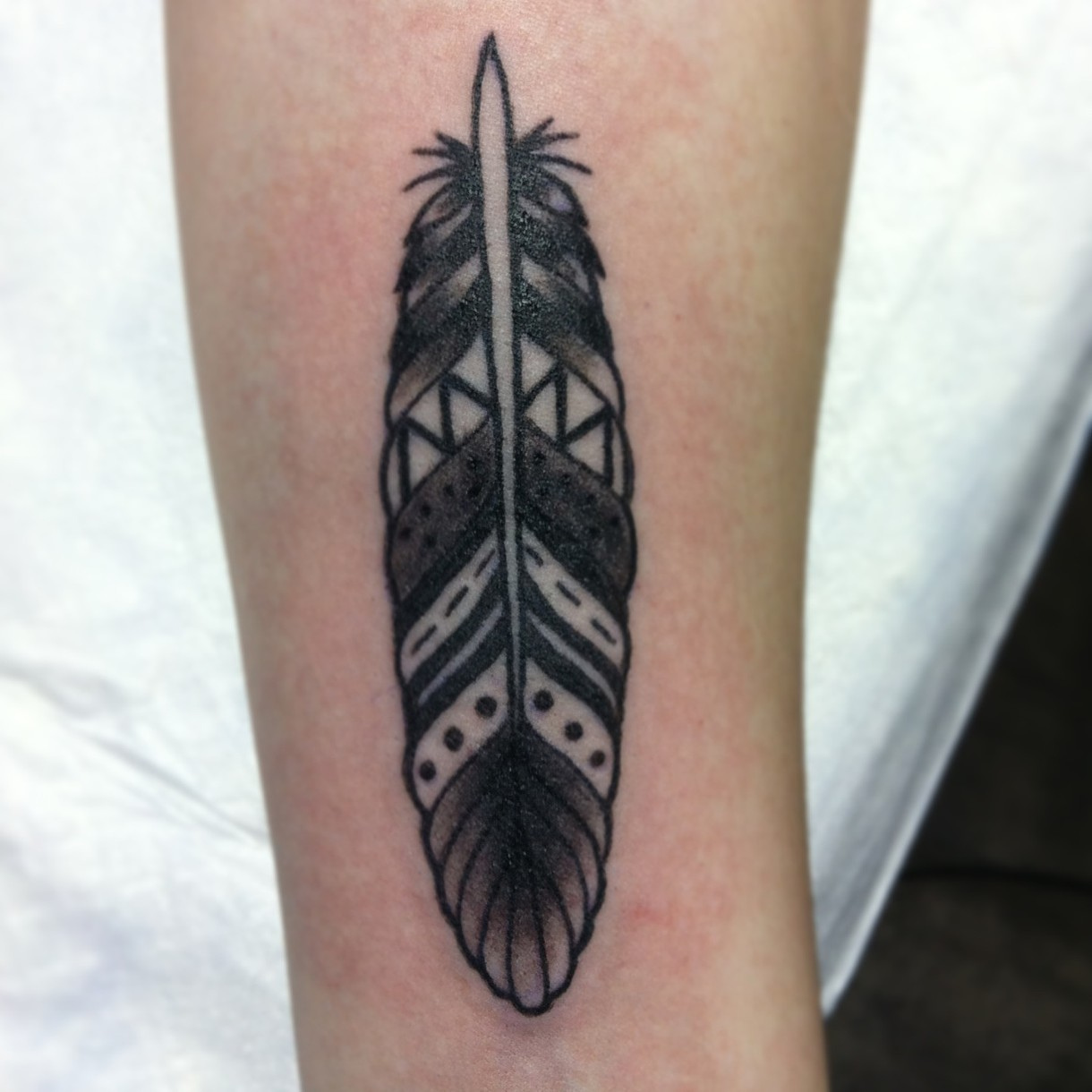 Inspiring Geometric Feather Tattoo On leg for girl