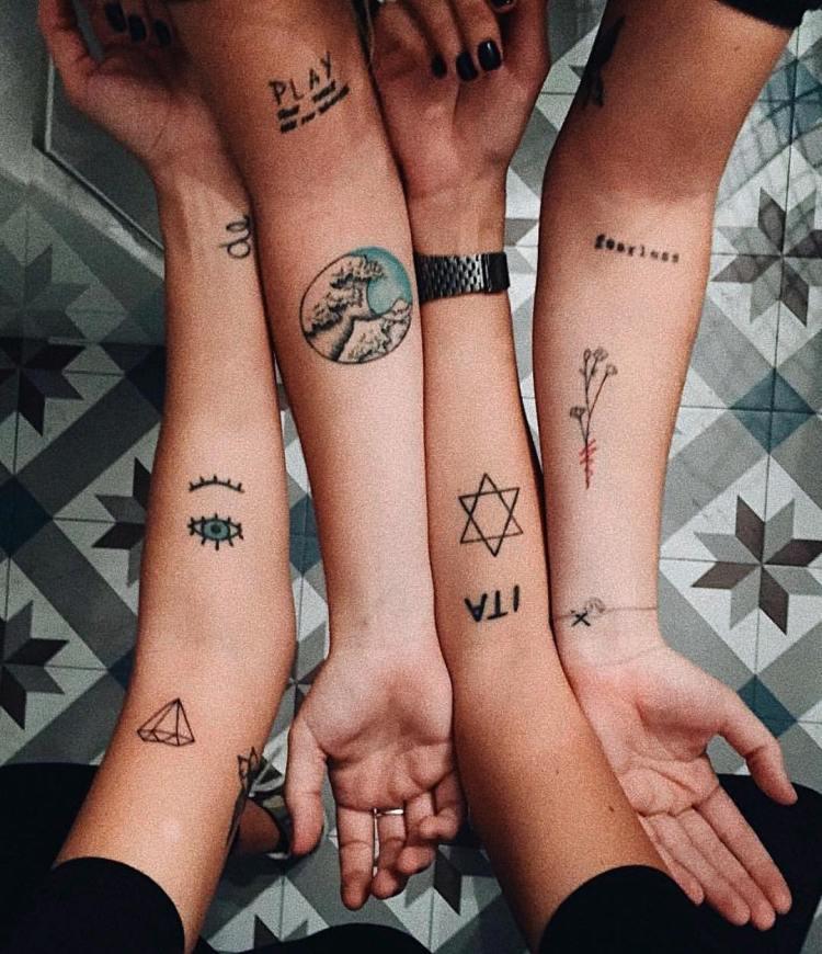 Amazing Symbol Tattoo For Girl Arm
