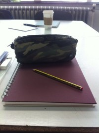 Home accessory: purple, notebook, starbucks coffee, pencil
