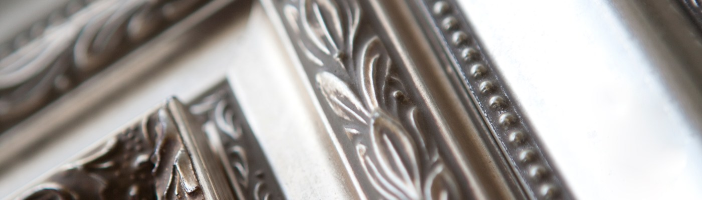 close up of ornate silver frame