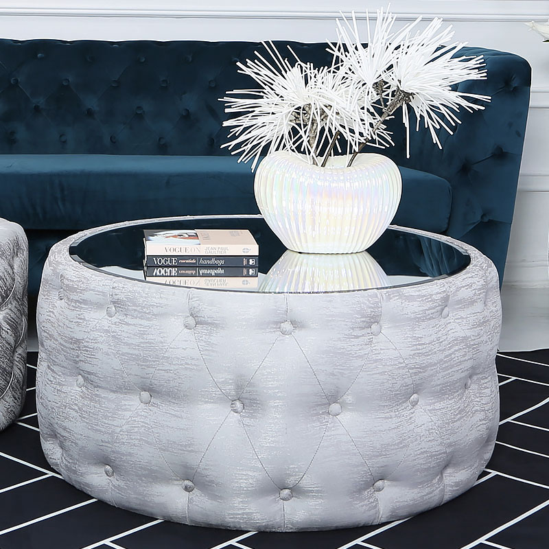 soft silver fabric coffee table with tufted buttons and mirrored top