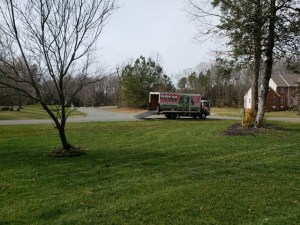 PPLM Pink Truck with Green Grass | DIY vs. Professional Lawn Care
