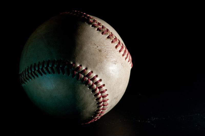 baseball flies through the air