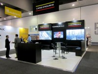 Our booth design with round table seating in brand colours as well as L-shaped seating were ideal for networking.