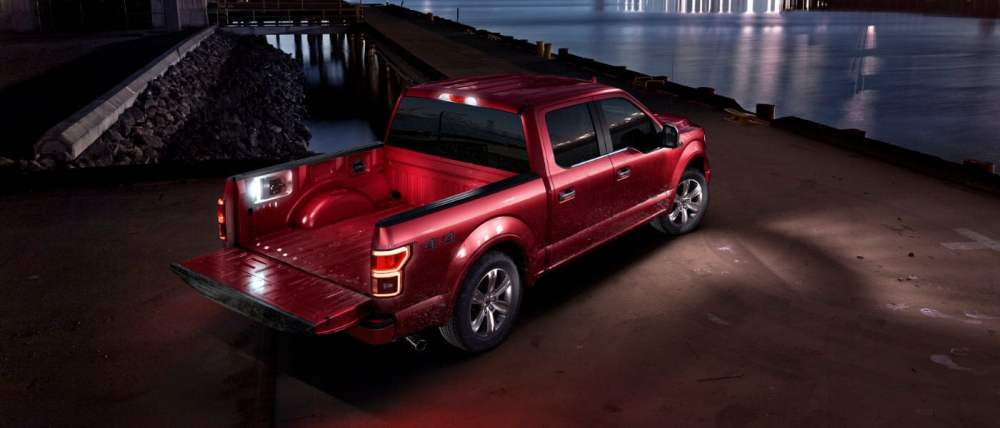 medium resolution of 2019 ford f 150 red parked by water at night