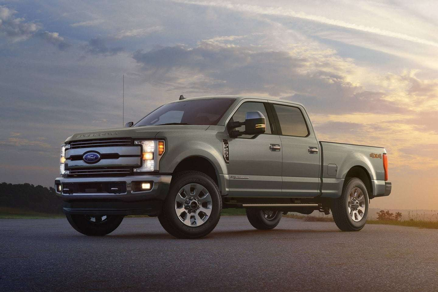 hight resolution of silver 2019 ford f 250 against a sunset background